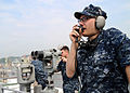 US Navy 100607-N-0120A-013 Operations Specialist Seaman Coty White, assigned to the forward-deployed amphibious assault ship USS Essex (LHD 2), reports surface contacts on a sound powered phone as a part of the special sea and.jpg