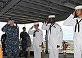 US Navy 100827-N-5620H-025 Rear Adm. Robert J. Kamensky crosses the quarterdeck aboard USS Frank Cable (AS 40).jpg