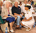US Navy 100925-N-6387D-131 Rear Adm. Eleanor V. Valentin, center, commander of Navy Medicine Support Command, speaks with WWII veteran, Marie Colli.jpg