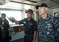 US Navy 110923-N-HA376-050 Capt. Wallace Lovely, deputy commodore of Task Group 73.1, speaks with a Bangladesh naval officer in the pilothouse aboa.jpg