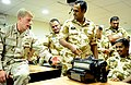US Navy 111115-N-RP435-143 Explosive Ordnance Disposal 1st Class Carey Peekstock shows Royal Bahrain Army explosive ordnance technicians a handheld.jpg