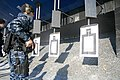 US Navy 111217-N-YK039-008 Master-at-Arms 2nd Class Scott Kroes draws his M9 service pistol during a weapons qualification event.jpg
