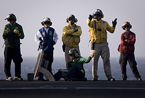 US Navy 120102-N-TZ605-601 A Sailor signals for a final check before launching an aircraft.jpg