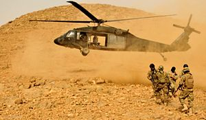 2012 in Afghanistan - US and Afghan soldiers on a mission to disrupt Taliban operations in Kandahar Province, March 16.