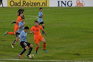 Stijn Schaars - Schaars pressing Luis Suárez during a match against Uruguay in 2011.