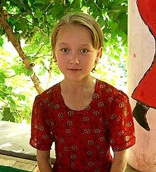 Bambina uigura bionda, Xinjiang, Cina.