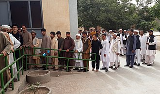 2014 Afghan presidential election - Voters queuing up in front of a polling center in western Herat province.