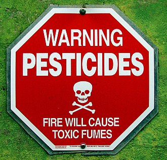 Pesticide - A sign warning about potential pesticide exposure