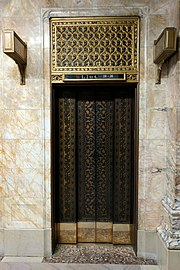 Photograph showing an ornately detailed elevator door