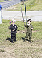 Young boys dressed as military members wave at the vehicles passing in the Veterans Day parade on highway 61 in La Place, La., on Nov. 11, 2013 131111-M-IJ438-130.jpg