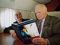 """Морис Дрюон с супругой Мадлен читают книгу В. С. Черномырдина """"Вызов""""в Оренбурге. 2003 год..jpg"""