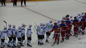 Slovenia men's national ice hockey team - Slovenia (in white), shakes hands with Russia at the 2014 Winter Olympics.