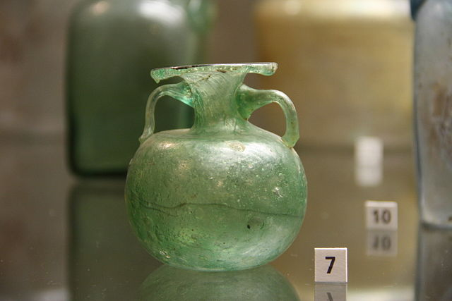Antique Roman perfume bottle of green glass, dating from 2nd Century, Archaeological Museum of Milan, Author Giovanni Dall'Orto (