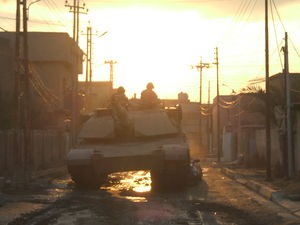 77th Armored Regiment - An M1A1 Abrams Main Battle Tank from Company A, 1st Battalion, 77th Armor Regiment destroys an insurgent vehicle in Baghdad, Iraq in 2007