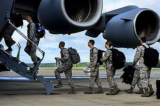 Operation United Assistance - Troops bound for Monrovia, Liberia board a transport aircraft (September 2014)