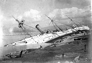 HMS Phoenix (1895) - HMS Phoenix foundered alongside a coaling pier in Hong Kong after a typhoon in 1906.