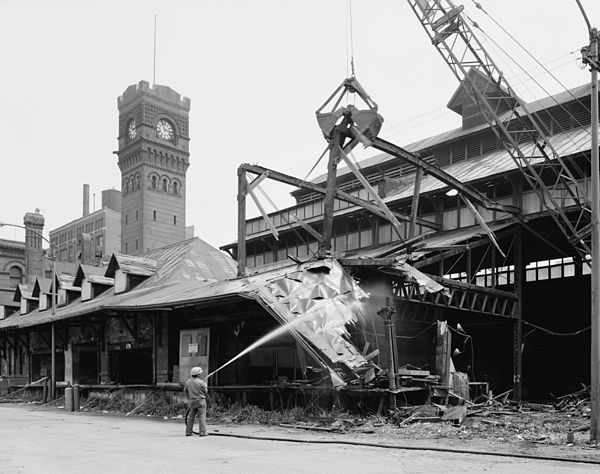 "The station's train shed being demolished in May 1976; the ""head house"" can be seen at the rear 1976 Dearborn Station.jpg"
