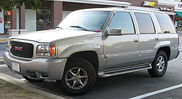 Gmt400 Gmc Yukon Denali Left Showing Similarities To The Escalade Right