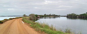 Mitchell River silt jetties - Panoramic view looking west along the Mitchell River silt jetties, with Lake King on the left.