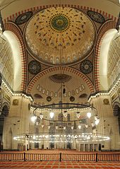 Interior view of the Süleymaniye Mosque with its large central dome.