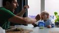 2013 Alberto Frigo Photographing Right Hand Feeding Kid.png