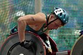 231000 - Athletics wheelchair racing 800m heat Kurt Fearnley concentrates - 3b - 2000 Sydney race photo.jpg