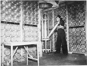 HMS Vanity (D28) - Inside Vanity's 4-inch Mk XVI shell room, October 1940