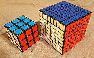 V-Cube 8 - Shengshou 8×8 compared to a 3×3×3