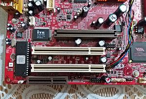 Accelerated Graphics Port - Universal AGP slot (brown, top) and PCI 2.2 slot (white beige, bottom)