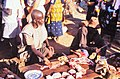ASC Leiden - W.E.A. van Beek Collection - Dogon markets 47 - Balugo showing his meat at the market, Tireli, Mali 1980.jpg