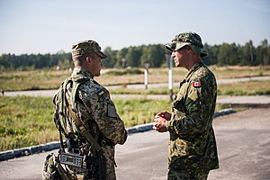 Ukrainian Ground Forces - Ukrainian and Canadian soldiers converse with each other during the 2014 Rapid Trident exercise in Yavoriv, Ukraine.