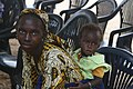 A Senegalese woman and child wait in line at a U.S. Marines Medical Civil Affairs Program makeshift medical compound.jpg