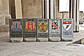 A T-wall painted with various military signs is seen at Camp Liberty, Iraq, July 7, 2011 110707-A-HR697-020.jpg