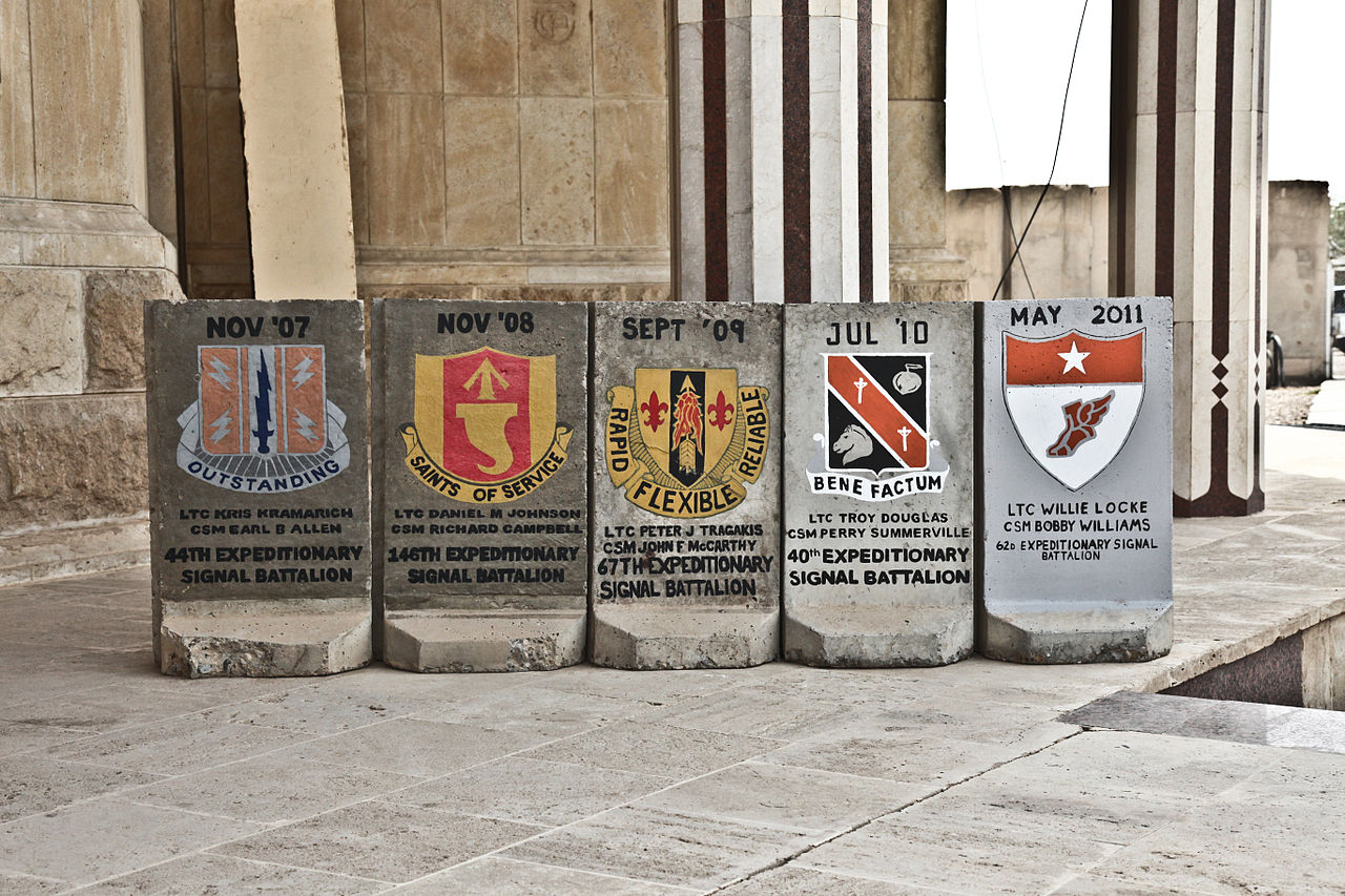 File A T Wall Painted With Various Military Signs Is Seen