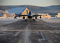 A U.S. Air Force F-16 Fighting Falcon aircraft assigned to the 18th Aggressor Squadron taxis to the flight line at Eielson Air Force Base in Alaska Feb. 10, 2014, en route to Andersen Air Force Base in Guam to 140210-F-FT438-004.jpg