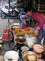 A fried cake vendor in Hanoi.jpg