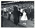 A girl receives an autograph from Frankie Laine at the Mayor's Charity Field Day (13561108715).jpg
