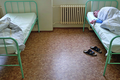 A patient sleeping in Ward 14 of the Bohnice Psychiatric Hospital in Prague.png