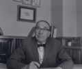 A photograph of Dr. Lionel Albert Walford at his desk.png