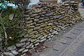 A stone wall made of a round stone seen in Iioka,Asahi city,Japan.jpg