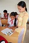 A teacher explains a lesson at the Kon Ray school. (5686006589).jpg