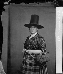 A woman in national dress and knitting (Lewis)