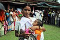 A young mother with her new born baby after casting her vote, at a polling booth of the Madhupur Dewri Gaon, for the 1st phase of Assembly Election, in Assam on April 04, 2011.jpg