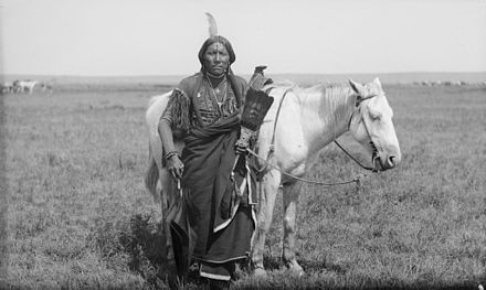 Comanche warrior Ako and horse. Photo by James Mooney, 1892. Ako, a Comanche warrior and horse -.jpg