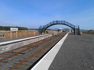 "Alnwick branch line - The new built ""Alnwick Lionheart"" terminus of the Aln Valley Railway. The A1 Alnwick bypass passes the site in a cutting immediately beyond the far boundary fence. 27 September 2015."