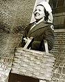 American Red Cross Recreation Unit volunteer carries equipment in a basket, WWII (34756220775).jpg