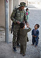 An Afghan National Army soldier gives a drink of water to a child during a joint vehicle checkpoint in Now Zad, Helmand province, Afghanistan, May 27, 2013 130527-M-TQ917-096.jpg