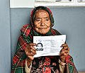 An elderly women showing her photo voter slip, at a polling booth, during the Meghalaya Assembly Election, in Shillong on February 27, 2018.jpg