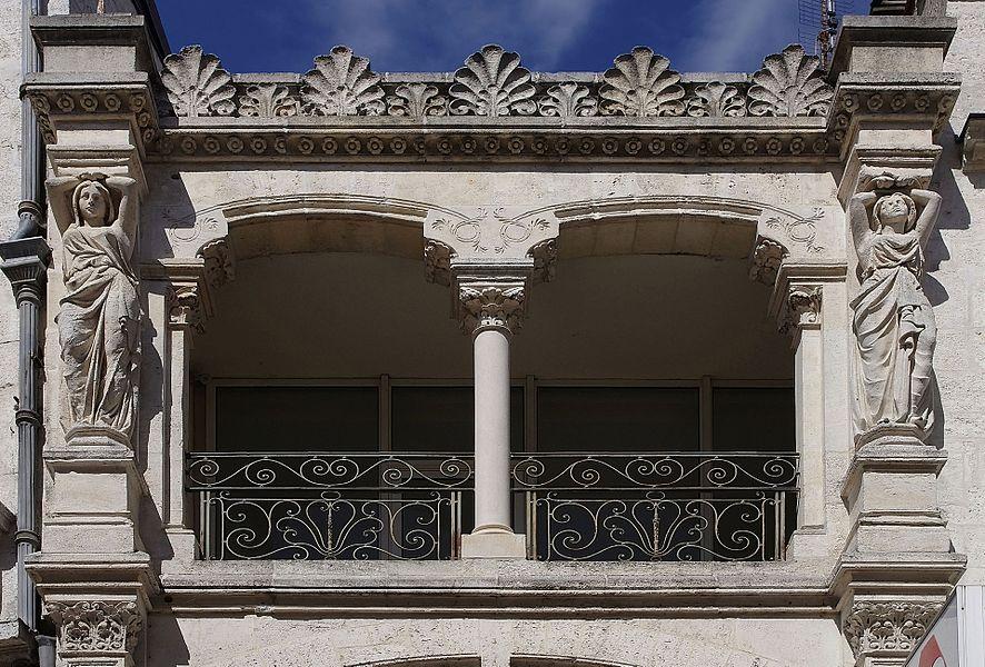 Balcony and caryatids (XIXth century), rue Hergé, Angoulême, France.