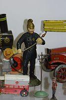 Antique toy fireman (26159283811).jpg